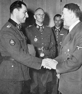 Léon-Degrelle-being-decorated-by-Adolf-Hitler-262x300