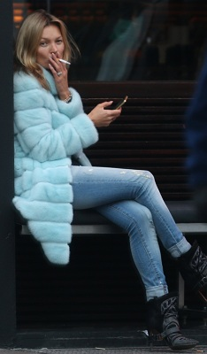 A make up free Kate Moss seen smoking in Notting Hill outside the E&O Restaurant