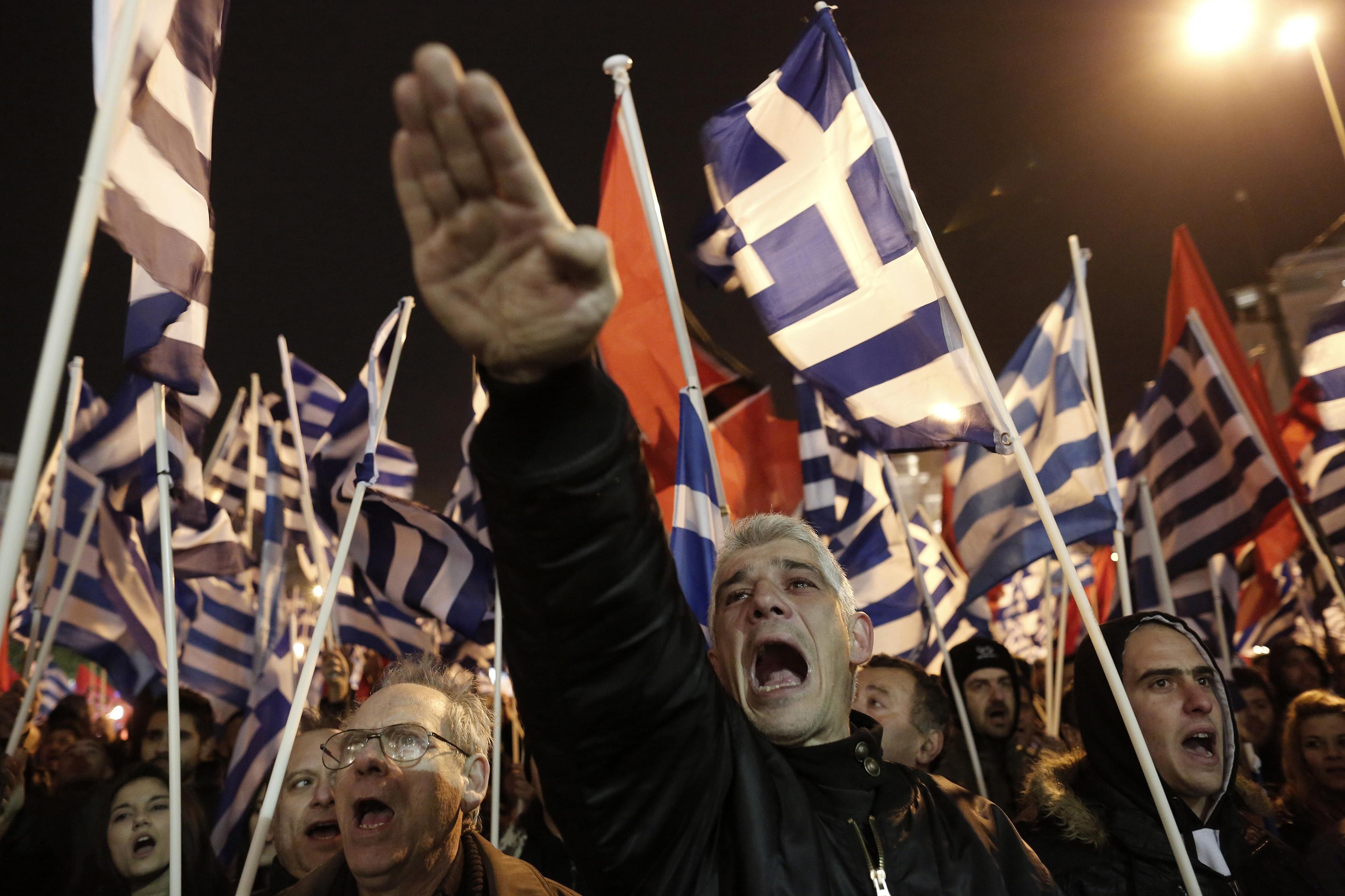 Imagen tomada durante una marcha de partidarios de Amanecer Dorado en Atenas | ©Yannis Kolesidis / AP Photo